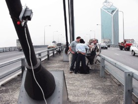 AES Staff Working at Rama 9 Bridge